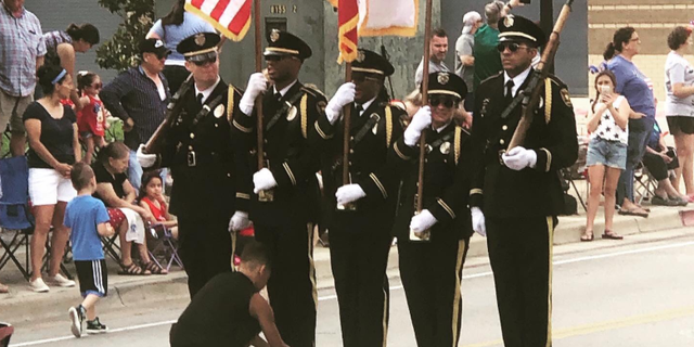 "The boy – identified by police as ""Josh"" – ran out at the start of the parade after he noticed one of the Honor Guard members holding the American flag had his shoe untied.<br>"