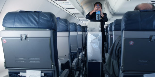 Flight attendant Kat Kamalani posted a video on TikTok explaining the grossest places on an airplane including the tray tables and seatbelt buckles. (iStock)