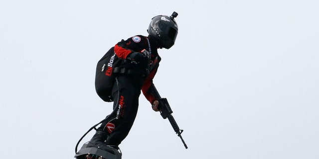 "Zapata CEO Franky Zapata flies a jet-powered hoverboard or ""Flyboard"" during the traditional Bastille Day military parade on the Champs-Elysees avenue Avenue on July 14, 2019 in Paris, France. (Getty Images)"