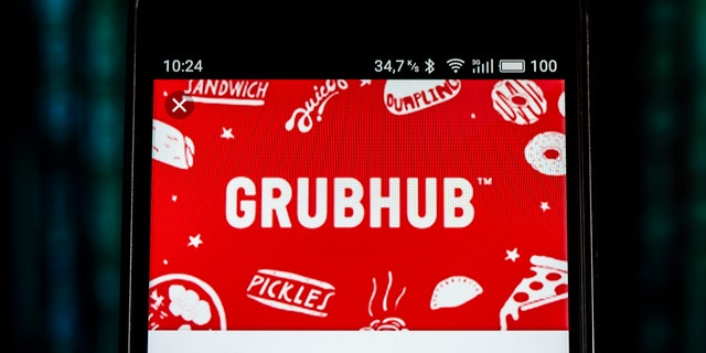 In this photo illustration, the GrubHub logo seen displayed on a smartphone.  (Photo Illustration by Igor Golovniov/SOPA Images/LightRocket via Getty Images)