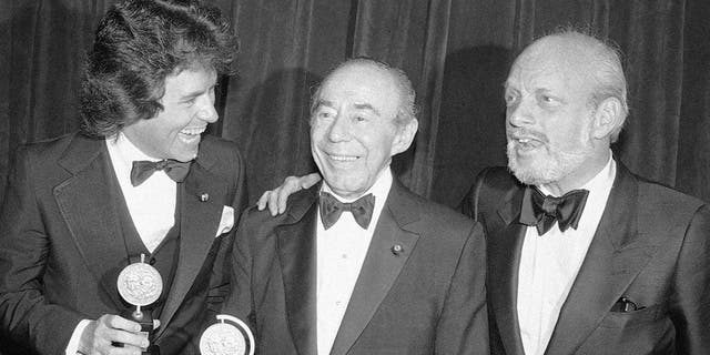 "In this June 4, 1979 file photo, Jack Hofsiss, left, and Hal Prince, right, flank Richard Rodgers at the Tony Award presentations in New York. Prince, who pushed the boundaries of musical theater with such groundbreaking shows as ""The Phantom of the Oepra,"" ""Cabaret,"" ""Company"" and ""Sweeney Todd"" and won a staggering 21 Tony Awards, died Wednesday, July 31, 2019, after a brief illness in Reykjavik, Iceland. He was 91."