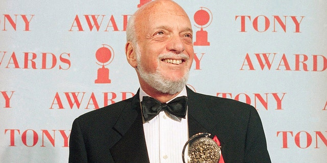 "In this June 4, 1995 file photo, Harold Prince holds his Tony award for best director in a musical for ""Show Boat,"" at Broadway's Minskoff Theater in New York. Prince, who pushed the boundaries of musical theater with such groundbreaking shows as ""The Phantom of the Oepra,"" ""Cabaret,"" ""Company"" and ""Sweeney Todd"" and won a staggering 21 Tony Awards, died Wednesday, July 31, 2019, after a brief illness in Reykjavik, Iceland. He was 91."