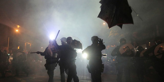 Hong Kong police launched tear gas at protesters Sunday after a massive pro-democracy march continued late into the evening.