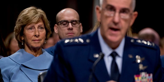 Gen. John Hyten, right, accompanied by his wife Laura, left, speaks before the Senate Armed Services Committee on Capitol Hill in Washington, Tuesday, July 30, 2019, for his confirmation hearing to be Vice Chairman of the Joint Chiefs of Staff.