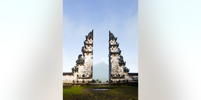 "Thousands of visitors flock to Lempuyang Temple in Karangasem each year, hoping to recreate photographs of them posing at the ""Gates of Heaven"" with their reflection captured in the water in front of the landmark -- which turns out to be fake."