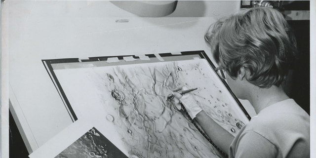 Photo of Patricia Bridges, one of a artists who combined airbrushed lunar maps during a ACIC (Aeronautical Chart and Information Center) housed during Lowell Observatory