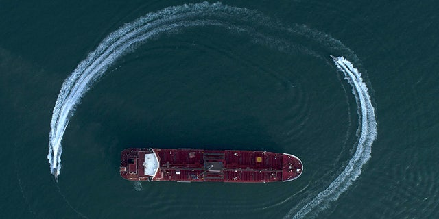 An aerial view shows a speedboat of Iran's Revolutionary Guard moving around the British-flagged oil tanker Stena Impero which was seized in the Strait of Hormuz on Friday. (AP/Tasnim News Agency)