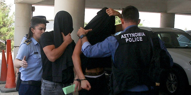 Israeli tourists, arrested over the alleged rape of a British tourist in the resort town of Ayia Napa, arrive to appear before a magistrate for a remand hearing in the Famagusta courthouse in Paralimni, Cyprus July 18, 2019.