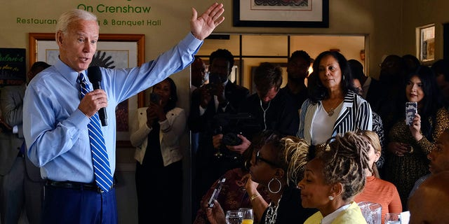 Democratic presidential candidate former Vice President Joe Biden speaks to community faith leaders after serving breakfast during a visit to Dulan's Soul Food on Crenshaw, Thursday, July 18, 2019, in Los Angeles. (Associated Press)