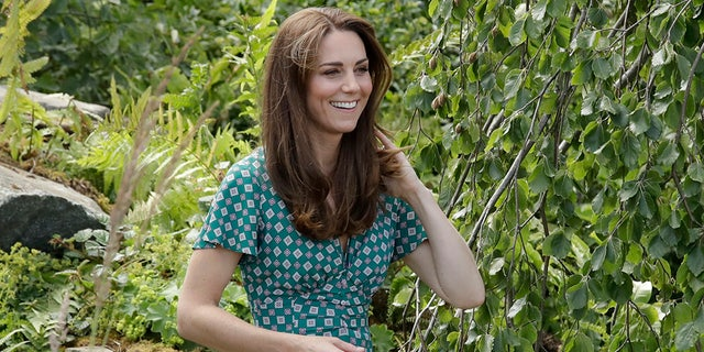 "Kate, the Duchess of Cambridge visits her ""Back to Nature"" show garden during the press day for the Royal Horticultural Society Hampton Court Palace Garden Festival in London in July."