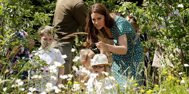 "Britain's Kate, the Duchess of Cambridge, visits her ""Back to Nature"" show garden during the press day for Hampton Court Palace Garden Festival in East Molesey, London, July 1, 2019. (AP)"