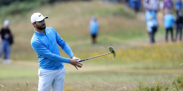 Kyle Stanley of the United States plays out of the rough on the 10th hole during the third round of the British Open Golf Championships at Royal Portrush in Northern Ireland, Saturday. (AP Photo / Peter Morrison)