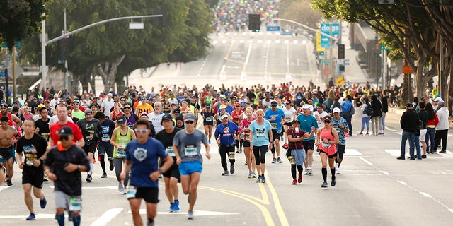 Runners stand First Street during a 2019 Skechers Performance Los Angeles Marathon Mar 24, 2019. (Photo by Katharine Lotze/Getty Images)