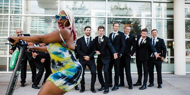 As soon as the groom and his party realized they had been photo-bombed, they tried to get her to come back and do it again – which she happily did.