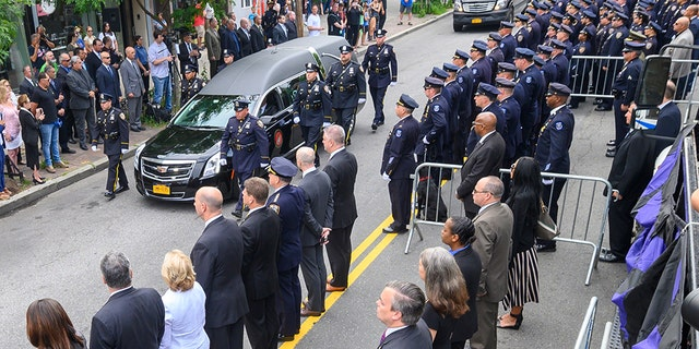 The casket of Detective Luis Alvarez is carried from Immaculate Conception Church, in the Queens borough of New York, following his funeral, Wednesday. (AP Photo/Richard Drew, Pool)