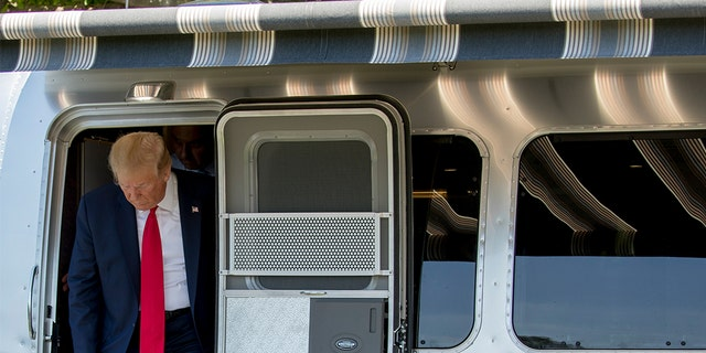 President Trump stepping out of an airstream trailer during the Made in America showcase on Monday. (AP Photo/Andrew Harnik)