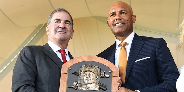 National Baseball Hall of Fame and Museum President Tim Mead, left, with inductee Mariano Rivera on Sunday in Cooperstown. (AP Photo/Hans Pennink)