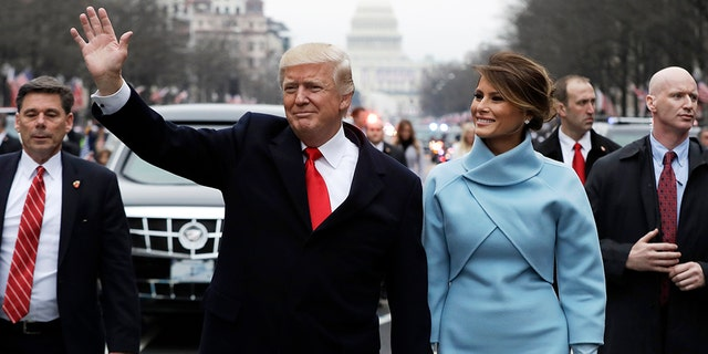 U.S. President Donald Trump and initial lady Melania Trump travel during a initial march from a U.S. Capitol in Washington, U.S., Jan 20, 2017.