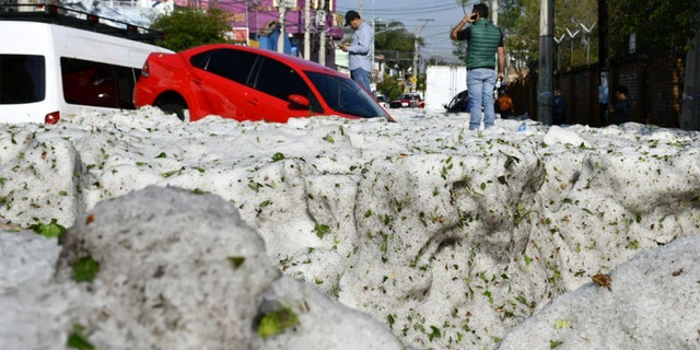 Vehicles lie entombed in ice after a freak hailstorm struck Guadalajara, Mexico on Sunday.