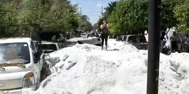 Up to five feet of hail fell from the storm early Sunday, swamping streets across Guadalajara, Mexico.