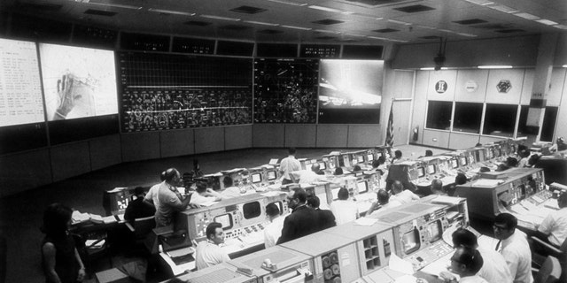 Overall view of the Mission Operations Control Room in the Mission Control Center, bldg 30, during the lunar surface extravehicular activity (EVA) of Apollo 11 Astronauts Neil A. Armstrong and Edwin E. Aldrin Jr. (Credit: NASA)