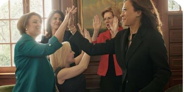 Five womanlike lawmakers shown in a Vogue print fire giving any other high fives.