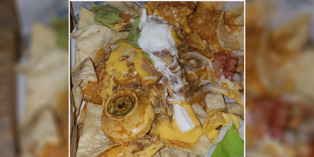 """Saint, who creatively suspicion a unfamiliar intent was a """"doorknob,"""" found out after it was indeed a """"nacho cheese handle,"""" that had somehow done it into her food."""