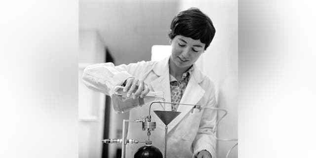Biologist Caye Johnson prepares a vitamin blend for the petri dish for lunar biological sampling at NASA's Ames Research Center in 1969. (Credit: NASA / Zabower)