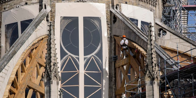Workers are pictured during preliminary work to repair the fire damage at the Notre-Dame de Paris Cathedral, in Paris, France, Wednesday, July 24, 2019.