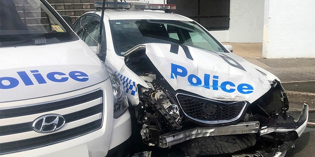 The scene after a van police say was carrying $140 million worth of meth crashed into a parked police car outside of Sydney.