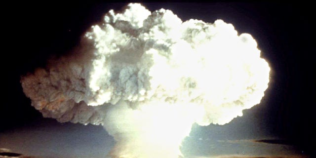 A nuclear test explosion from April 1954 is shown from the US Defense Department.