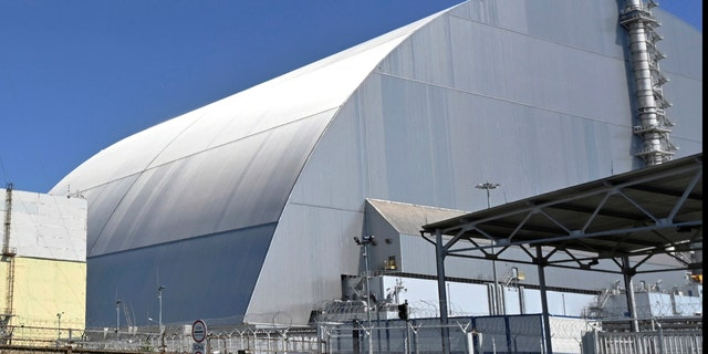 This June 1, 2019, file photo shows a view of the New Safe Confinement (NSC) movable enclosure at the nuclear power plant in Chernobyl, Ukraine. A new structure built to confine the Chernobyl nuclear reactor at the center of the world's worst nuclear disaster has been previewed for the media. (Sergei Supinsky/Pool Photo via AP, File)