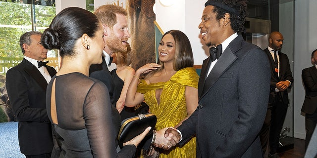 "Prince Harry and Meghan Markle greet Beyoncé and Jay-Z at the London premiere of ""The Lion King."""