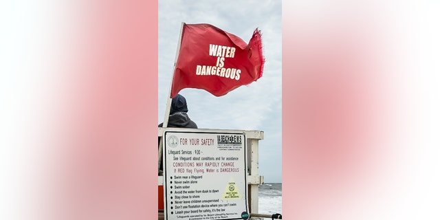 On Tuesday, when Rabbi Reuven Bauman jumped into choppy waters to save a student, lifeguards had raised red flags prohibiting swimming due to dangerous conditions.