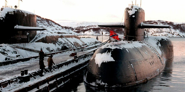 FILE - In this file photo taken on Thursday, Jan. 1, 1998, Decommissioned Russian nuclear submarines are shown in their Arctic base of Severomorsk, the Kola Peninsula, Russia. (AP Photo)