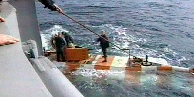 In this video grab provided by the RU-RTR Russian television via APTN , Russia rescue personnel return from a dive in a mini submarine to the Kursk on the sea bed in the Barents Sea, Russia. (RU-RTR Russian Television via AP)