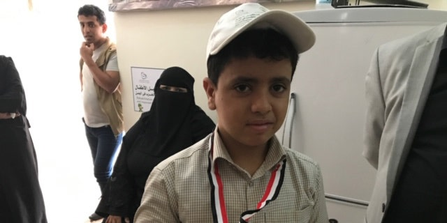 A young boy seeking help in the government-controlled Ma'rib having escaped Sana'a