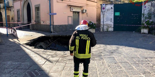 Italian firefighters said the massive sinkhole in Naples was about 26 feet wide and 40 feet deep.