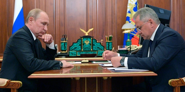 Russian President Vladimir Putin listens to Russian Defense Minister Sergei Shoigu during their meeting in the Kremlin in Moscow, Russia, Tuesday, July 2, 2019. (Alexei Druzhinin, Sputnik, Kremlin Pool Photo via AP)