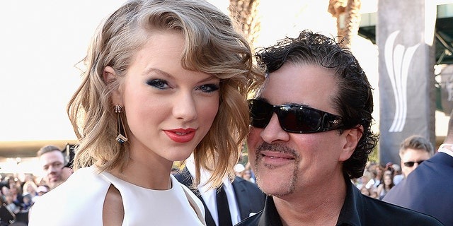 Taylor Swift and Big Machine Label Group President and CEO Scott Borchetta attend the 49th Annual Academy of Country Music Awards at the MGM Grand Garden Arena on April 6, 2014 in Las Vegas. Swift slammed Borchetta for selling the Big Machine record label to Scooter Braun, who used to represent her nemesis, Kanye West.