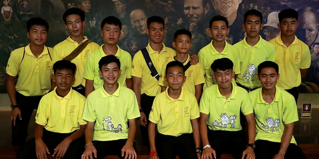 Members of the Wild Boars soccer team pose for a photo during their return to the Tham Luang caves, where they were trapped in a year ago, in Chiang Rai, Thailand, June 24.