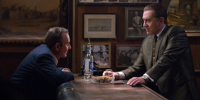 """This image released by Netflix shows Joe Pesci, left, and Robert De Niro in a scene from """"The Irishman."""" The film will make its world premiere at opening night of the New York Film Festival on September 27."""