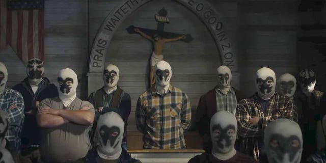 """A scene is depicted in HBO's """"Watchmen."""" The show, a continuation of the story in Alan Moore's DC graphic novel, will examine white supremacy and have Robert Redford as president."""