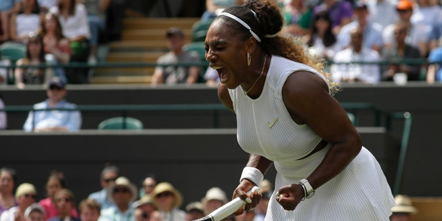 Serena Williams celebrates winning a point against Spain's Carla Suarez Navarro in a women's singles match during day seven of the Wimbledon Tennis Championships in London, July 8, 2019. (AP Photo/Kirsty Wigglesworth)