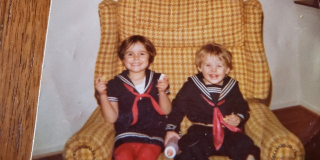 Shannon and her younger brother Sean Schieber sitting in their childhood home in Maryland.