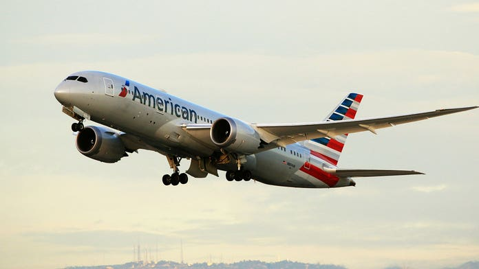Children on American Airlines flight not fed, given medication during 13-hour delay, parents claim