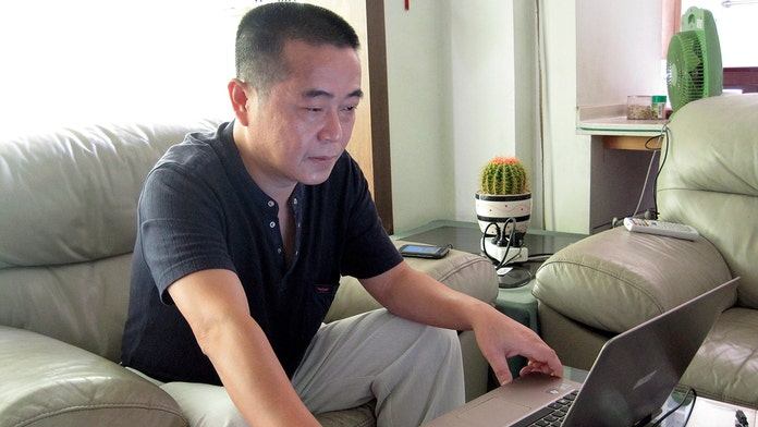China sentences online activist to 12 years in prison for allegedly leaking secrets
