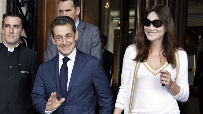 Nicolas Sarkozy, at 5 feet 5 inches, mocked for magazine showing him taller than supermodel wife Carla Bruni