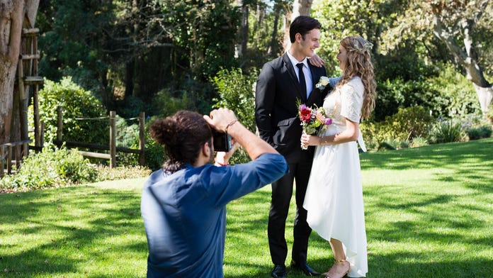 Photographer shares wedding photo ruined by iPhone user: 'you took this moment away from the bride'