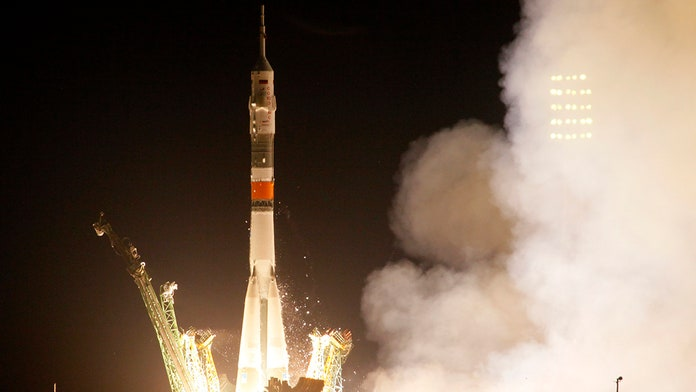 On Apollo 11 anniversary, US astronaut blasts off to the space station in a Russian Soyuz spacecraft